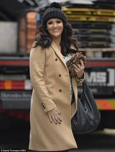 Beige beauty: Martine McCutcheon looked chic in her camel coat and beanie hat outside ITV sutdios