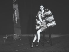Model Hilary Rhoda poses in fur jacket and slip dress from Dennis Basso