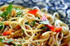Asian pasta salad with thin vermicelli pasta, sesame oil, soy sauce, crushed red chili pepper, honey, and cilantro.