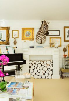 mantle inspiration- maybe not the mounted zebra, but love the stacked wood!