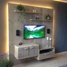 Wow, this is another pattern of pallet wood wall cladding. This is actually a comprehensive wooden pallet creation that counts as a room interior decoration plan, a wooden pallet TV stand plus a wooden pallet shelf that can be used to display multiple decoration pieces on its racks.