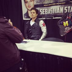 Sebastian Stan wearing a fan's Winter Soldier jacket at Chicago Comic Con 2014