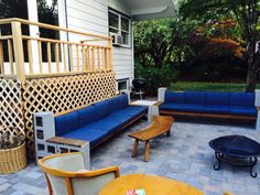 DIY cinder block cement sectional sofa with wood beams on paver patio
