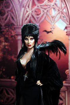 http://www.ncruz.com/newsite/Elvira.php Noel Cruz's repainted and restyled Elvira by TONNER doll signed by Cassandra Peterson July 2017. See more of Noel's work at http://www.ncruz.com.