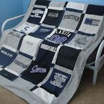 I've always wanted to make the girls one of these. Crafty ideas #42. Memory T-Shirt Quilt