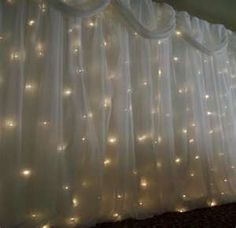 Fabric and lights. Perfect for hiding a not so great looking backdrop.