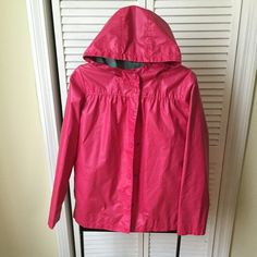 Pink rain coat Kids size extra large, but I couldn't resist and bought it. Fits me, and I'm Small. There is a small white spot on the back, but it is not too noticeable. Cherokee Jackets & Coats