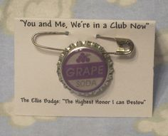 "Up ""Ellie Badge"" Grape Soda Pin Disney Pixar Inspired Bottle cap. $2.50, via Etsy."