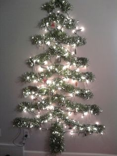 alternative christmas tree for a small space items used 12 feet tinsel garland cut into different lengths 25 commandtm hooks 1 strand of lights not