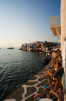 an early cocktail by the sea, Mykonos, Greece