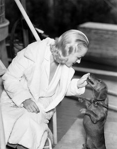 Carole Lombard, 1930's publicity photo with doxie friend.