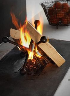 a contemporary take on the traditional fire basket - Ferrari Opus Focus Alea Iron Wing Fire Basket, Fire Pit Landscaping, Light My Fire, Fireplace Design, Metal Fireplace, Backyard Fireplace, Metal Projects, Wood Storage, Blacksmithing