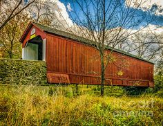 The Van Sant Covered Bridge in Bucks County Pa. It is 86 feet long and 15 feet wide and utilizes one span, it crosses Pidcock Creek