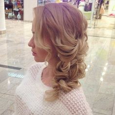 Curly Hair into a Loose Braid Hairstyle