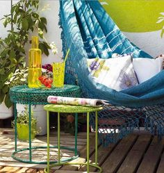 Hammocks aren't only for the beach; you can get them for your balcony as well. Give the beach feeling to your balcony and tie a colorful beach hammock outside with native decorative furniture to go with it.