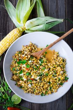 Mexican Street Corn with chilies, cilantro and lime - also called Elotes. This lighter version can be grilled or sautéed and can easily be made vegan!   www.feastingathome.com