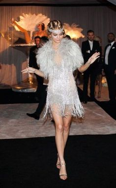 The Great Gatsby Dress – Best Seller! This shimmery, silver, and exotic dress simply screams the fashion from the Great Gatsby. The added touch of the fur with a matching jeweled headband ties the whole outfit into place for the Ariana Andino The Great Gatsby, Great Gatsby Dresses, Great Gatsby Fashion, 1920s Fashion Gatsby, 1920s Party Dresses, Roaring 20s Dresses, Gatsby Wedding Dress, Roaring 20s Fashion, 1920s Dress Gatsby
