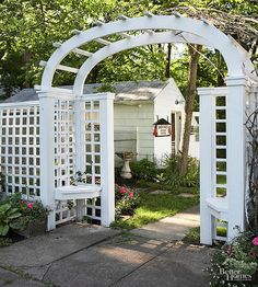 A little bit pergola, a little bit trellis, a little bit arbor, this charming structure blends in the best of those three hardscape items to create a lovely entrance to this cottage garden's side space. Narrow seating nooks offer restful spots, while the pergola-arbor's overhead spacing offers room enough for a flowering vine.