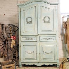 Shabby Chic Armoire makeover for a plain armoireadding embellishments and then