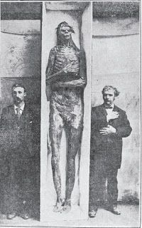 Actual photo of a 9 foot human giant that was discovered near San Diego, California. The man on the right is from the Smithsonian. Giants were real!