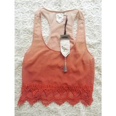 {boutique} 'white crow' ombre tank Brand new with tags ombre orange ombre tank with lace details on the bottom front. Brand is White Crow.   Delicate, pretty and unique.  Would look great paired with high waisted jean shorts for a festival or a fun day out.   Size small. white crow Tops Tank Tops