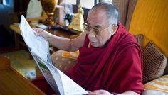 The Dalai Lama reads.