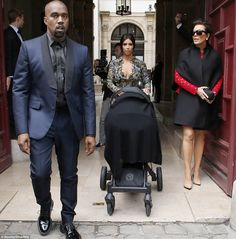 And we're off! Kim and Kanye began the wedding extravaganza early on Friday morning. They left their hotel with baby North - and Kris Jenner...