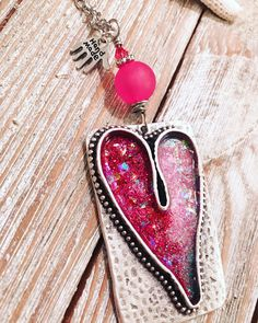 A personal favorite from my Etsy shop https://www.etsy.com/listing/547324023/pewter-heart-pendant-with-pink-glitter