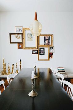 Fantastic picture arrangement. Love the whole room especially the gold candle holders.