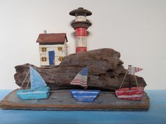 Light House cottage. Made from driftwood and old bits of metal. By Sea side art design by Philippa Komercharo. FB page.