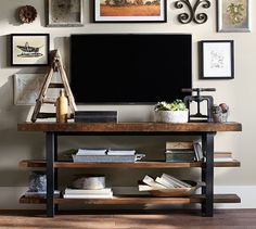 Sipping wine on the sofa and staring at this Griffin Reclaimed Wood Media Console sounds like a perfect evening plan to us!