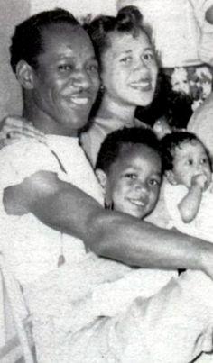 JIMI:  Jimi Hendrix with parents and Leon