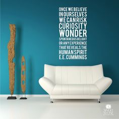 A typography wall decal piece in subway art style featuring a quote by ee cummings. The text reads:    Once we believe  in ourselves  we can