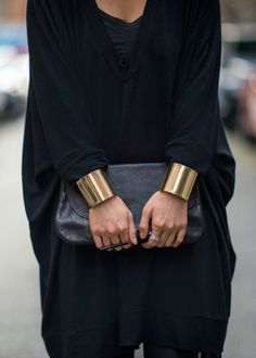 An all black outfit with gold statement cuff bracelets - yep, we love it.