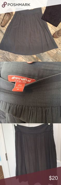 Alternative Apparel Slate Gray Linen Midi Skirt Slate gray Alternative Orange Label skirt. Alternative is a cool eco brand that uses organic/sustainable materials while also maintaining a high standard for chicness! This is an airy linen skirt (I wore a slip underneath cuz....yeah, it's airy!). Button closure at side and pockets! Small stain right by the buttons, not noticeable bc it's basically inside of the pocket when it's on. Approx measurements = 25.5 in from top of waist to bottom of…