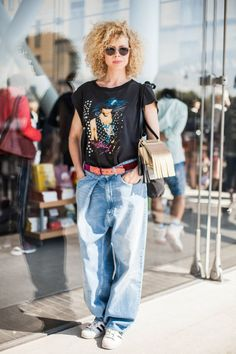 18 Killer Looks From The Whitney's Debut Weekend #refinery29  http://www.refinery29.com/2015/05/86550/best-dressed-whitney-museum-opening#slide-1  Name: Maya Vik Job: MusicianWhat She's Wearing: Wired jeans, adidas sneakers, Kaboosh sunglasses, and Acne Studios bag and belt.Sometimes, bigger is better, especially when it's in the form of an oversized concert tee and boyfriend jeans.