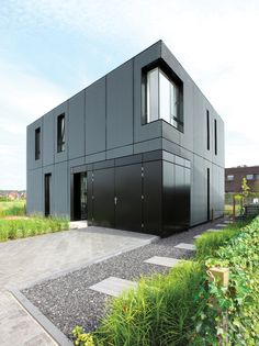 Villa DVT, BoetzkesHelder Architects, Arnheim Netherlands. powder coated aluminum rain screen application, 10cm rain screen gap, color varies from gray- blue.