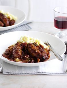 This recipe for sausages braised with smoky bacon and cider is a poshed-up sausage and mash and it's a guaranteed crowd-pleaser. It takes a little while but is really easy to make.
