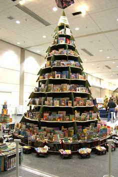 Book tree surrounded by red wagons filled with books. Lovely display.