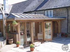 Green Oak and Glass Conservatory Extension and Orangery with Glazed Roof Lantern in Cornwall by Carpenter Oak Ltd Devon Small Conservatory, Conservatory Extension, Cottage Extension, Glass Extension, Roof Extension, Extension Ideas, Extension Google, Garden Room Extensions, House Extensions