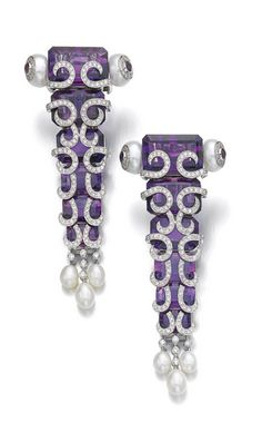 Best of Birthstones: Arresting Amethyst - Pair of amethyst, cultured pearl and diamond ear clips, Khan Mutlu. These decadent cascading amethyst ear clips are enhanced by brilliant-cut diamond scroll motifs and dangling pearls. Pearl And Diamond Earrings, Diamond Earing, Amethyst Earrings, Purple Jewelry, Amethyst Jewelry, Cultured Pearls, Chandelier Earrings, Bracelets, Vintage Jewelry