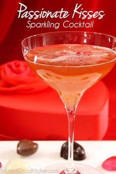 Passionate Kisses Sparkling Cocktail by WickedGoodKitchen.com ~ Fun rum-based sparkling cocktail with passion fruit syrup for Valentine's Day! I love red! Valentine's Day ideas