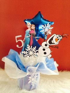 Frozen centerpiece, cake toppers @  www.etsy.com/shop/AzulDreams  Awesome for a Frozen theme party