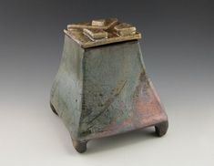"""This raku box features subtle color variations and unique one-of-a-kind lid design reminiscent of Aztec design. 6.25"""" H x 5.5"""" x 5.5"""" Available now. by Natasha Poppe"""