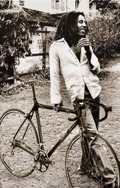 Bob Marley with a bike - not. I just found out this is a photoshopped picture - the real photo shows Marley with a neck of a guitar in his right hand.