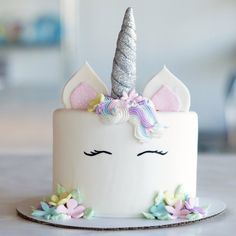We've seen a ton of gorgeous unicorn cakes all over Pinterest, and we couldn't help but be smitten by their magical whimsy. We partnered with one of our favorite cake decorators over at Duff's Cakemix to help us bring this cake to life. It really is quite a beautiful thing to watch! Would you want one of these cakes at your next party?
