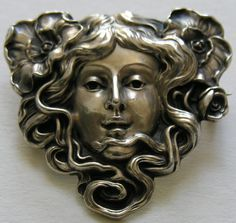 Unger Poppy Lady Sterling Brooch  This classic Unger brooch features an Art Nouveau lady with poppies in her hair.
