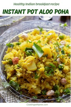 INSTANT POT ALOO POHA - This traditional Indian breakfast recipe made with rice flakes, potatoes and green peas is flavored with cury leaves, peanuts and lemon. Serve this with a cup of chai for a comforting meal!  #instantpot #indianbreakfast #veganrecipe #cookingwithpree