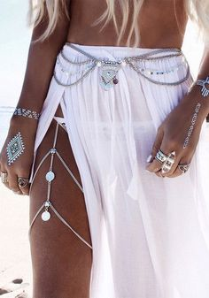 This summer, don't settle for the usual boring beach clothing. Amp up your swimwear game with this silver boho layered belly chain.