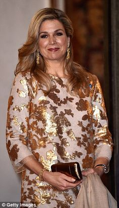 Queen of style: Queen Maxima put on an equally stylish display for the dinner in her honou...